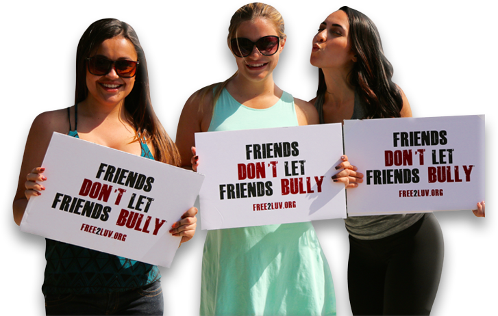 three girls holding Free2Luv sign of friends don't let friends bully
